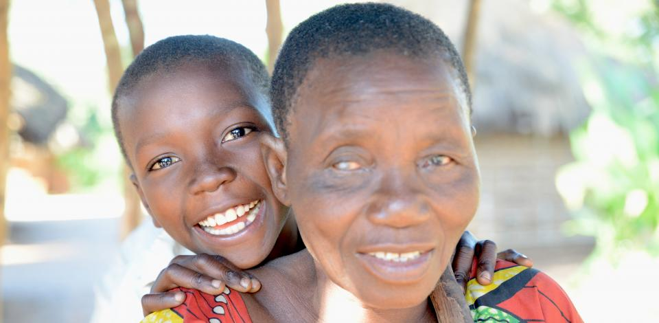 Berthine (64) is blind due to onchocerciasis. Here with her grandchild Jean (8).