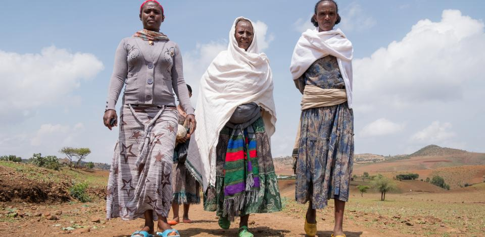 Wlubnesh Fentaye Adane, 50, center, leaves the health post with CBM-supported health extension worker Asefu Ayalew, left, in Faya, Amhara Region, Ethiopia, on May 20, 2017. Also pictured is Adane's sister, Birhanie Mekonnen, at right.